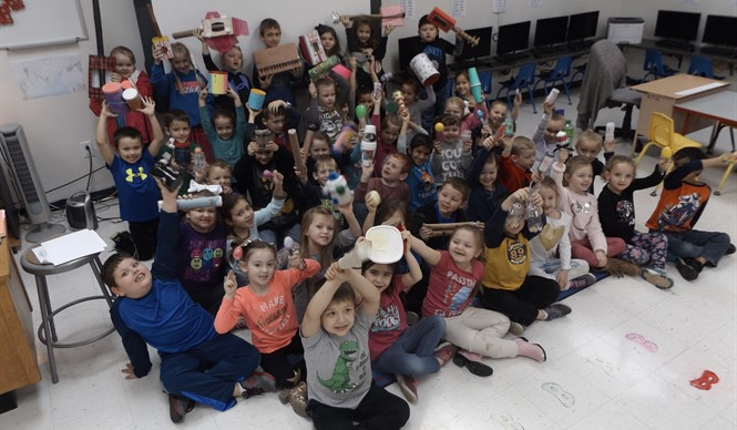 Kindergarten students in Mrs. Cindy Wallace's related arts classes at ECC show off some of their Cyber Day work - homemade musical instruments!