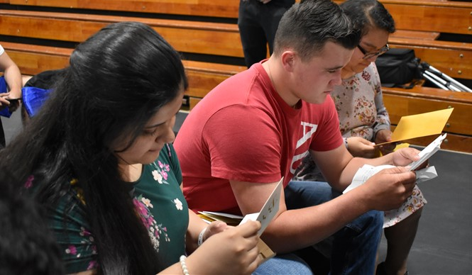 During graduation practice on the last day of school, seniors were surprised with letters from family and friends.