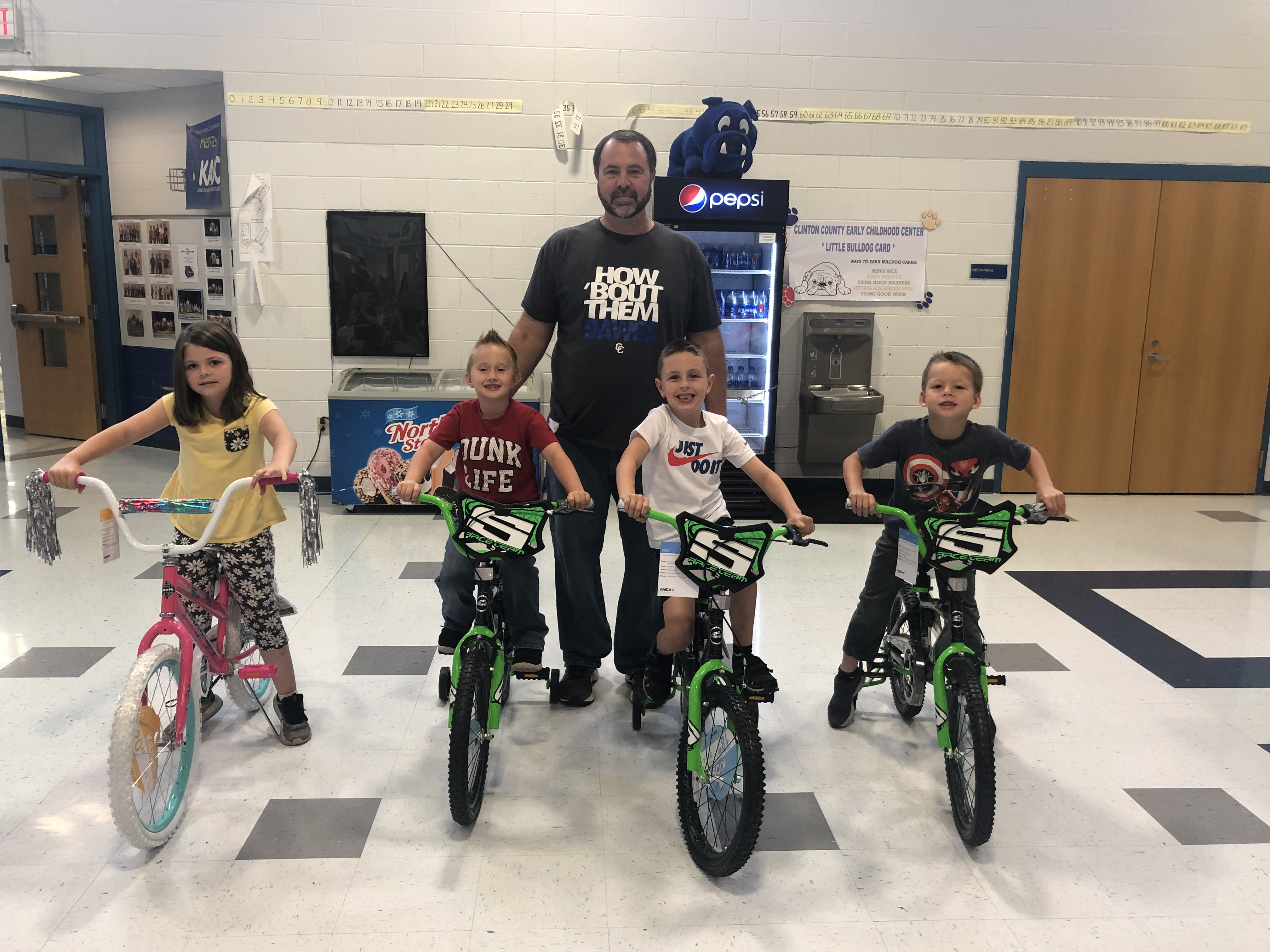 Calirose Johnson, Carson Wells, Bentley Creekmore, & Knoxx Duvall received new bikes on the last day of school for having perfect attendance at ECC during the 2018-19 school year.