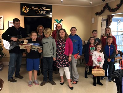 Members of the CCMS FCA visited Clinton County Care & Rehab on Tuesday, December 12th to deliver Christmas cards and to sing Christmas carols.