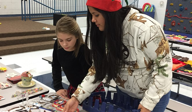 FBLA volunteers assist student shoppers at the annual Christmas Village.