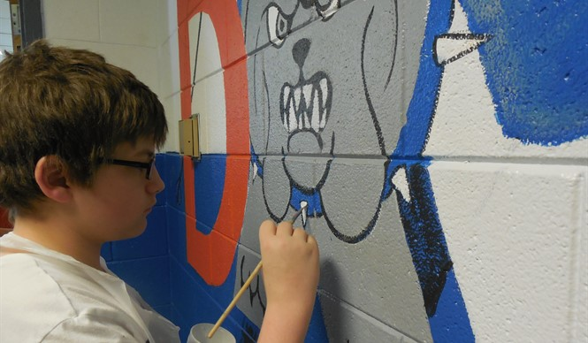 CCMS 8th grade students paint a mural during the VSA Arts Inclusion Project.