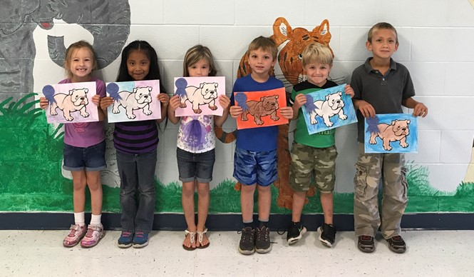 Kindergarten students proudly show off their ribbons as winners of the Bulldog Coloring Contest at ECC.
