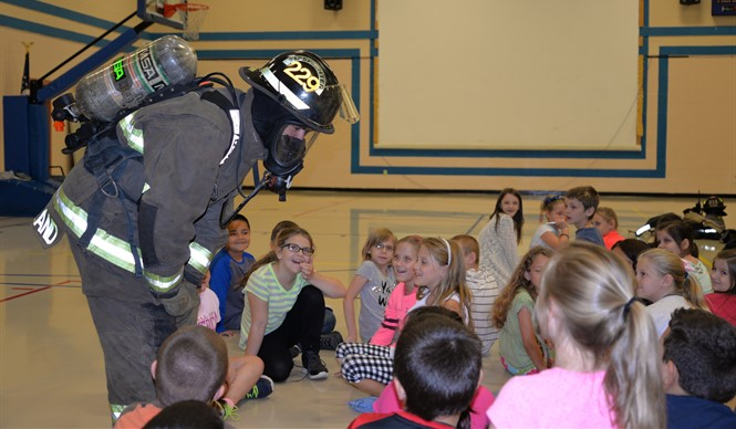 Members of the Albany Fire Department talk to AES students at Fire Safety Day.