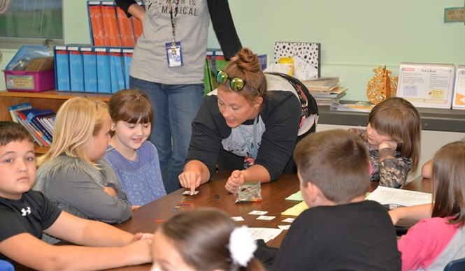 Students enjoy games with their teachers during Family Math Night at AES.