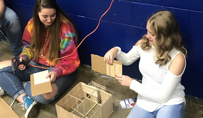 CCHS Agriculture students build Popsicle stick barns.