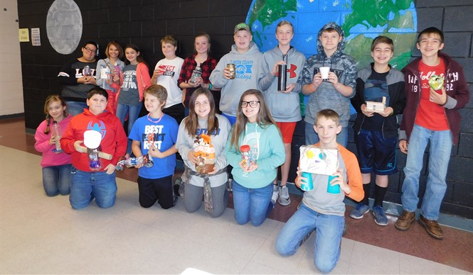 Students in Mrs. Lora Grant's 5th and 6th practical living & career studies classes at CCMS are pictured here with their RRR projects.