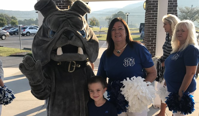 Students at the Clinton County Early Childhood Center were greeted with cheers, high fives from the bulldog, and a wave of blue and white on High Attendance Day!