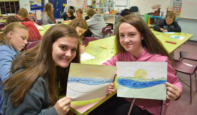 During the Showcasing the Arts program at AES and CCMS, students used their own creativity and imagination to finish an incomplete landscape created using only basic shapes and lines.
