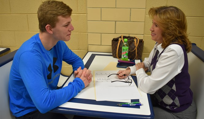 Volunteer mentors met one-on-one with 8th and 10th grade students during Operation Preparation.