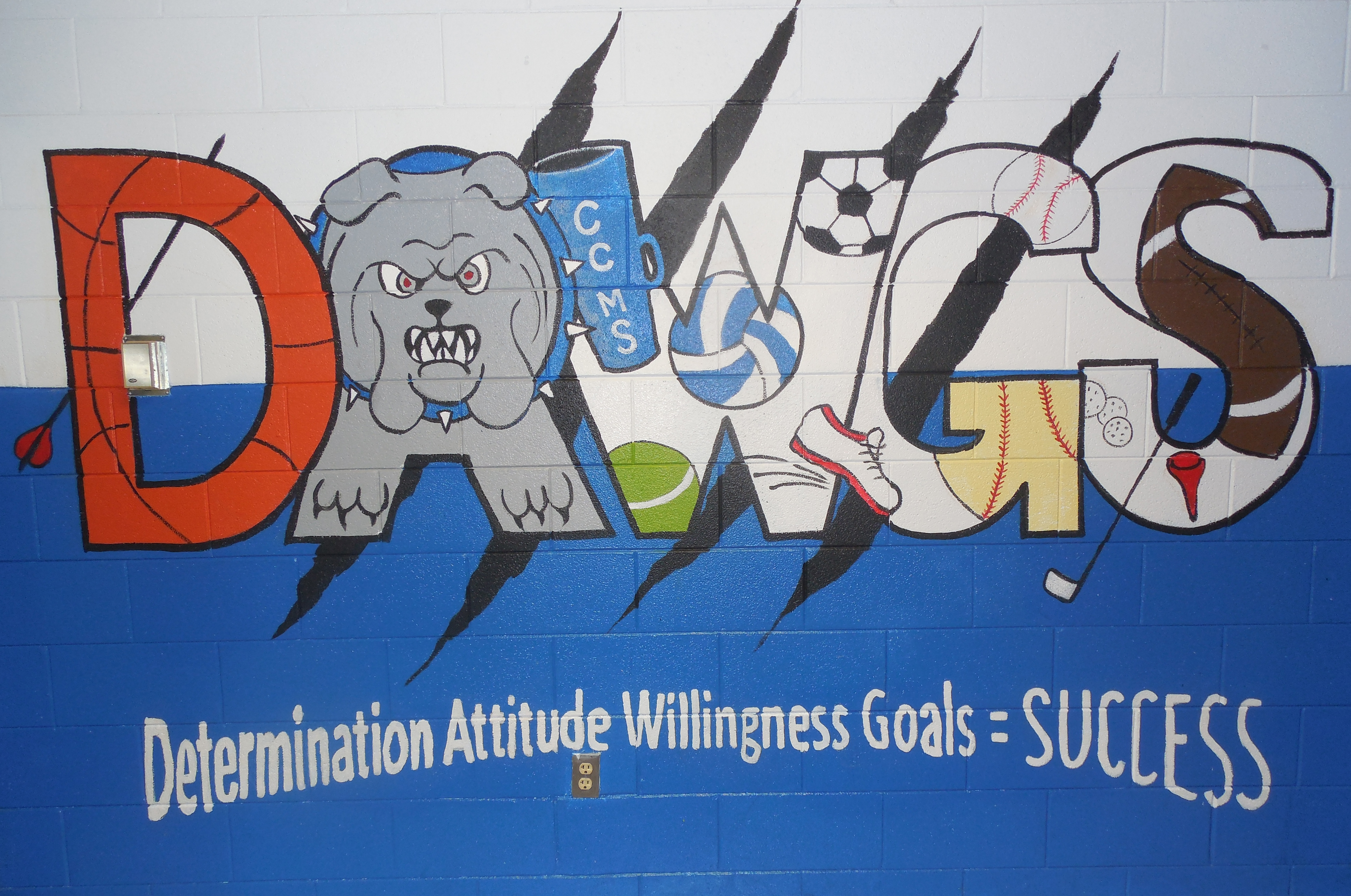 A mural depicting the DAWGS motto was the culminating activity in the VSA Arts Inclusion Project at CCMS.