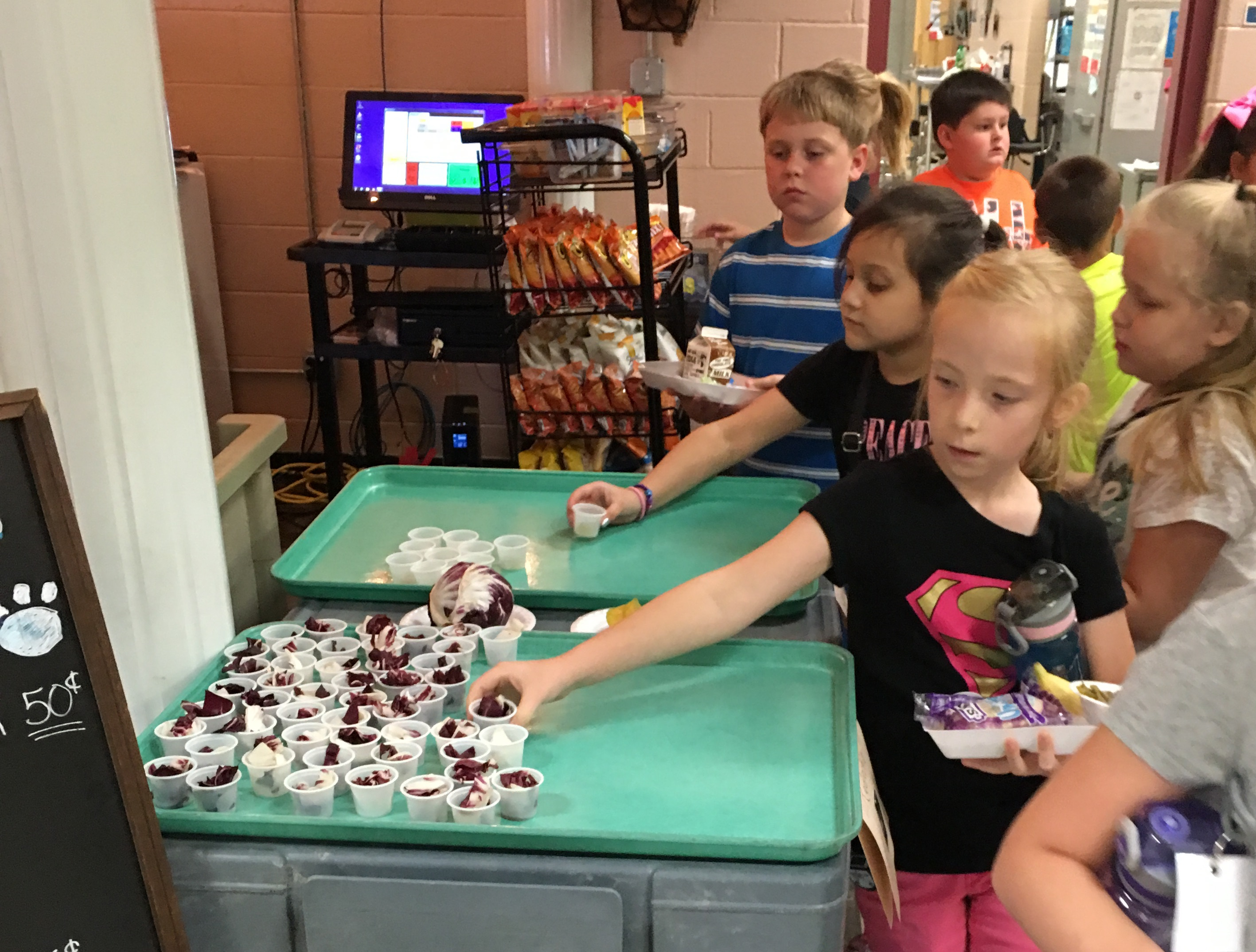 Students at ECC and AES had the opportunity to try starfruit and radicchio during the September Healthy Taste of the Month on Tuesday, September 13th.
